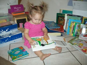 Lexi, 18 months, enjoying the touch & feel books