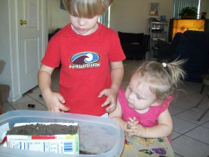 Zander planting seeds & Lexi observing
