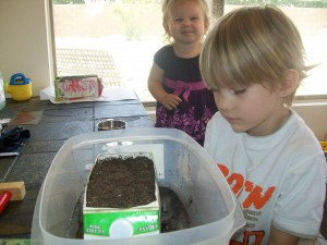 Zander and Lexi watering the Spinach seeds
