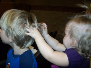Lexi playing with Zander's hair