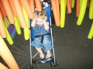 Mommy pushing Lexi thru the Noodle Forest.