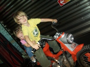 Zander and Lexi on the motorcycle.