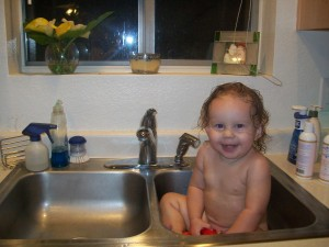 Lexi getting a bath in the sink.