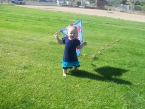 Lexi having fun with the kite.