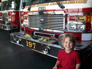 Zander super excited to see and touch the fire truck!