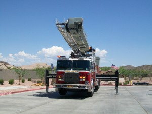 Ladder truck beginning to put ladder up.