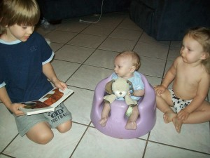 Zander reading Brown Bear, Brown Bear to Lexi and Aiden