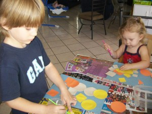 Zander and Lexi glueing shapes.